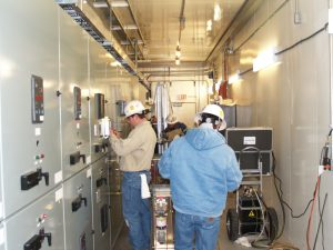 Men in Industrial Area Testing Electrical